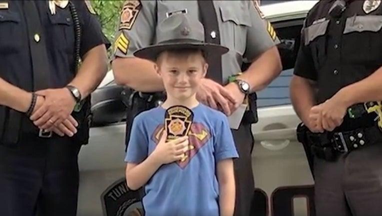 dd2e33df-PA troopers surprise boy raising money for neighbors_1498592578810-401096.jpg