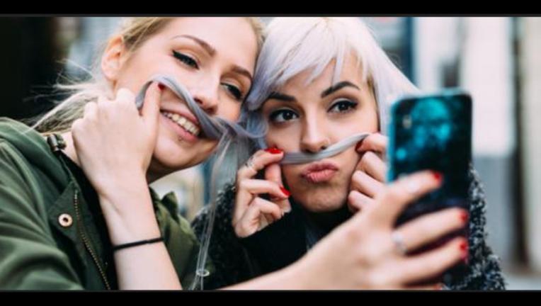 0dd82892-Millennial teens grow up more slowly