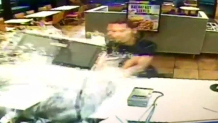 f74fee18-Still image from Taco Bell surveillance video provided by North Smithfield Rhode Island Police-404023
