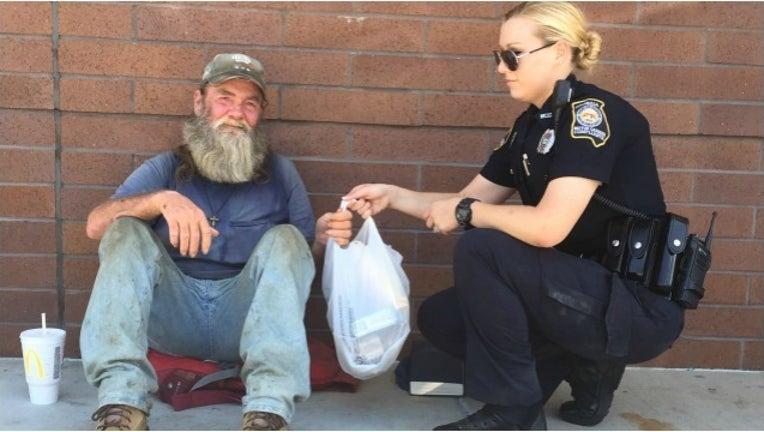 bd7f781e-officer helps man in need_1469207926243.jpg