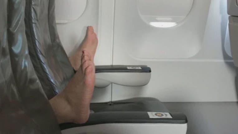 c2acf6f7-Feet on a plane-401720.jpg
