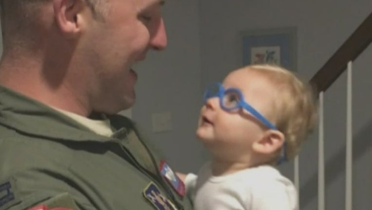 c8bc17a5-Baby sees dad_1489842333426.jpg