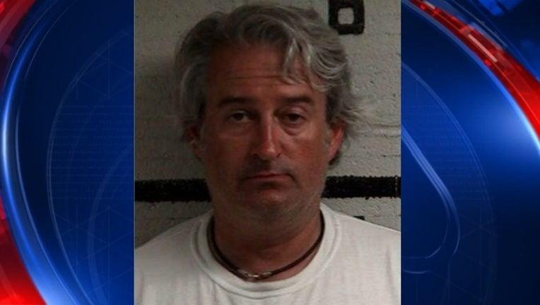 37dea5ef-douglasville officer arrested_1503585155494.jpg
