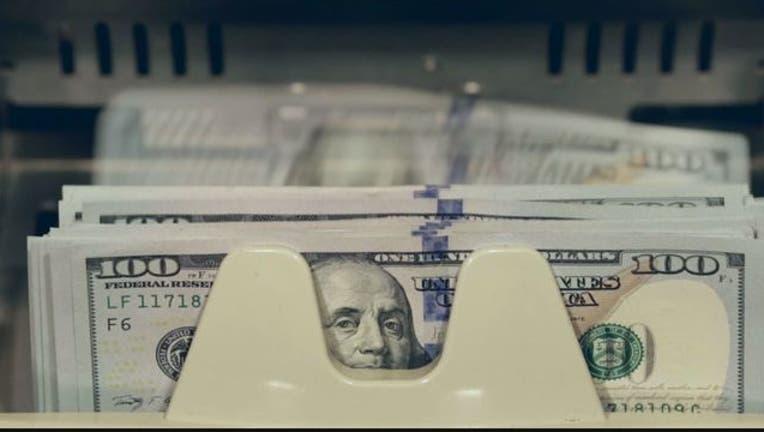 ee51d384-WTTG 100 dollar bills 101118-401720