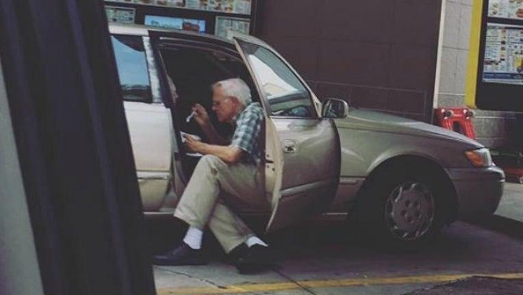 b56ed7bc-elderly man feeds wife_1501158924097.jpg