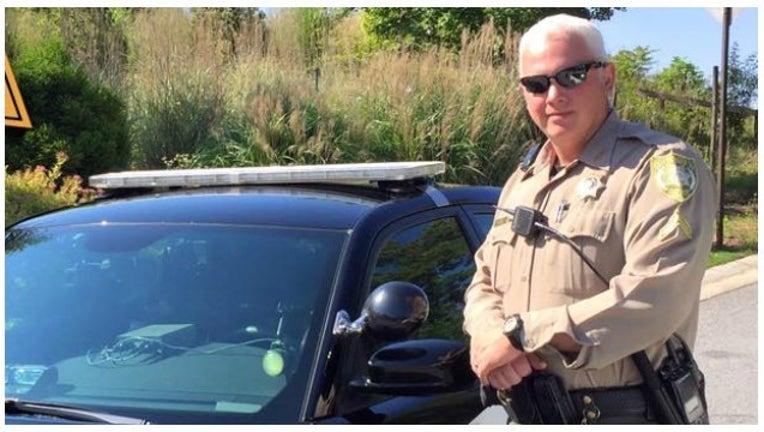 51cf50ab-forsyth deputy saves teen_1464018714706.jpg