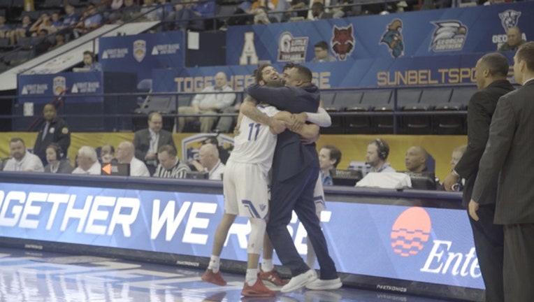14d2510a-Georgia State hug Sun Belt final