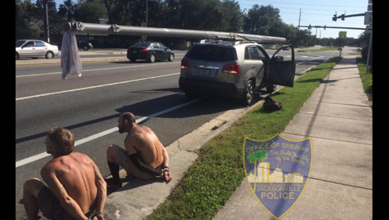 jacksonville police arrest looters_1505404166070-407068.PNG