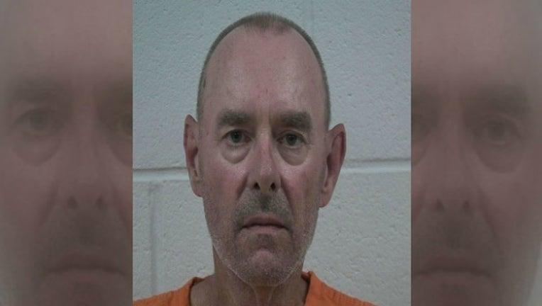 52593c1a-jailer arrested_1469100789771.jpg