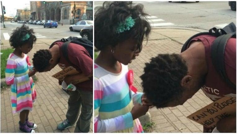 32ed048d-little girl prays with homeless man_1463047106452.jpg