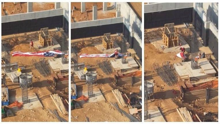 46128863-man folds flag_1467649382702.jpg