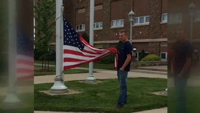 ohio teen holds flag_1464347785552.jpg