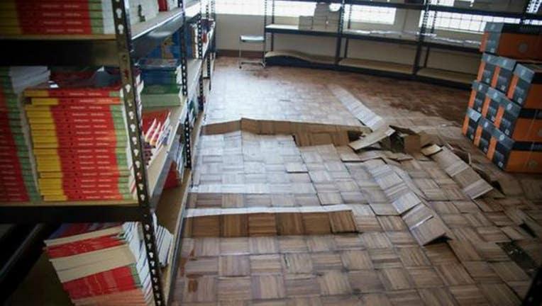 f4b62ab3-Damaged floors inside Hilliard Elementary in Houston-404023