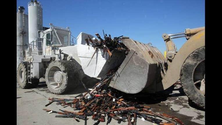 5910c367-thousands of guns_1469311137442-407068.jpg