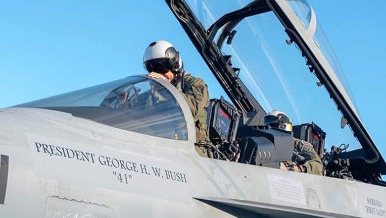 us navy flyover jet_1544114101265.jpg-408795.jpg