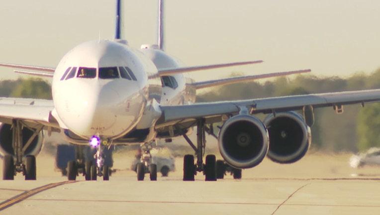 23ba260e-waga atlanta airport planes taxiway front_1558986817161.jpg.jpg