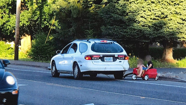 Woman arrested after police spot her pulling her two kids behind her car - photo courtesy Springfield Police Department-404023
