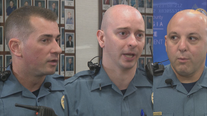 Police officers save man pinned by car