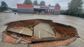 Sinkhole forms in parking lot of Dawson County business