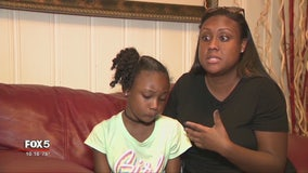 8-year-old held at gunpoint on school playground
