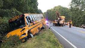 Police search for driver who hit Cherokee County school bus