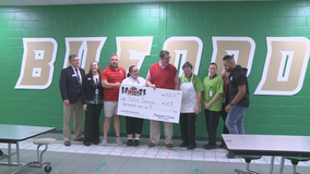 Roofing company pays off school lunch debts in Buford