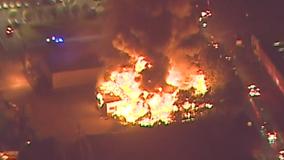 Fire crews battle hot spots after massive blaze near I-285, area remains closed