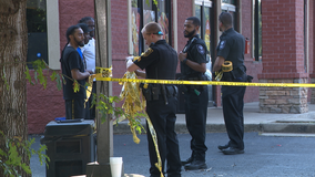 Shooting outside a barber shop sends 3 people to the hospital
