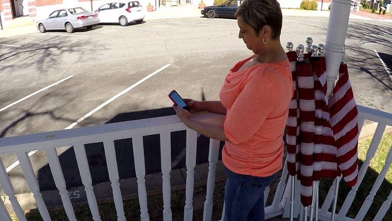 woman sitting in gazebo look at her phone