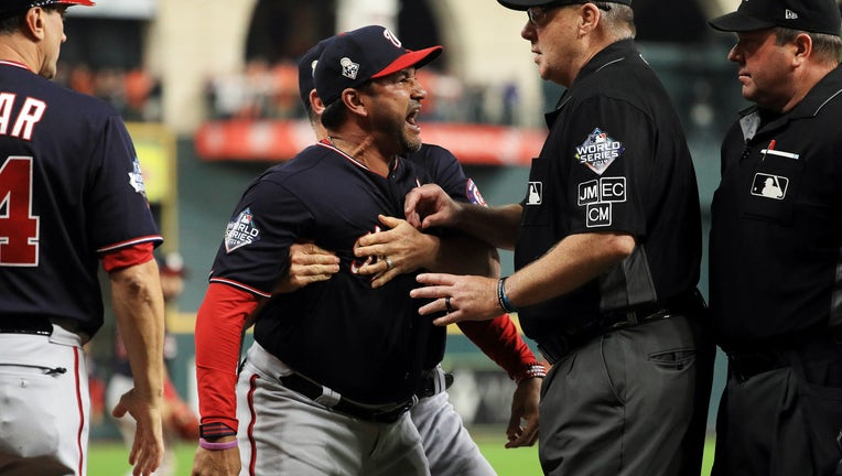 HOUSTON, TEXAS - OCTOBER 29: Dave Martinez #4 of the Washington Nationals argues as he is ejected by the umpire and is held back by Bob Henley #14 against the Houston Astros after the top of the seventh inning in Game Six of the 2019 World Series at Minute Maid Park on October 29, 2019 in Houston, Texas.