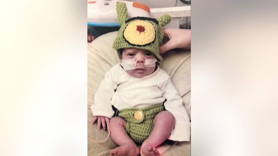 Baby wears Halloween costume.