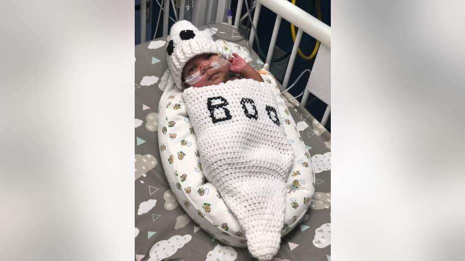 Baby wears Casper the Friendly Ghost Halloween costume