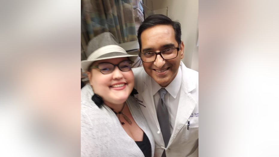 Cristen Reagan poses with Dr. Asif Saberi, WellStar Kennestone's Medical Director of Critical Care and ECMO