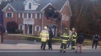2 dead after Porsche crashes into 2nd floor of building