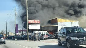 Firefighters battle massive blaze at Douglasville auto shop