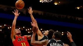 Young dazzles in 2nd half, Hawks beat Spurs without Collins