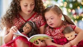 American Girl holiday catalog features 'electric' 4-year-old girl with Down syndrome in dazzling red gown