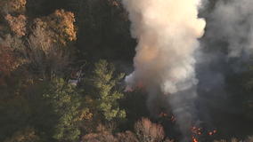 Firefighter: Massive Cobb County house fire sparked in garage