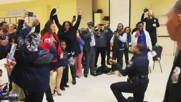 Watch as this police academy graduate proposes to his girlfriend