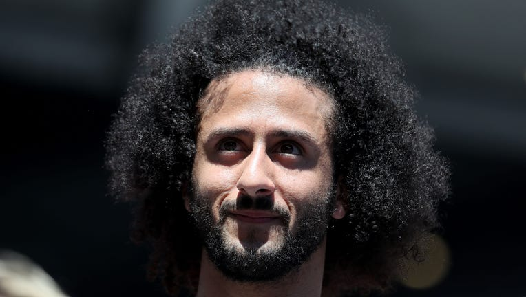 Former San Francisco 49er Colin Kaepernick watches a Women's Singles second round match between Naomi Osaka of Japan and Magda Linette of Poland on day four of the 2019 US Open at the USTA Billie Jean King National Tennis Center on August 29, 2019 in Queens borough of New York City. (Photo by Al Bello/Getty Images)