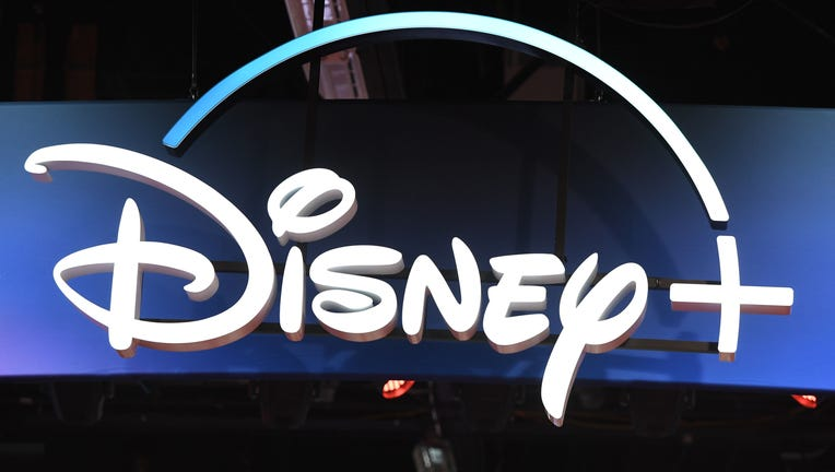 A Disney+ streaming service sign is pictured at the D23 Expo, billed as the