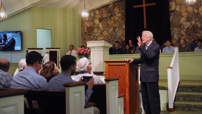 Former U.S. President Jimmy Carter speaks to the congregation at Maranatha Baptist Church before teaching Sunday school in his hometown of Plains, Georgia on April 28, 2019. Carter, 94, has taught Sunday school at the church on a regular basis since leaving the White House in 1981, drawing hundreds of visitors who arrive hours before the 10:00 am lesson in order to get a seat and have a photograph taken with the former President and former First Lady Rosalynn Carter. (Photo by Paul Hennessy/NurPhoto via Getty Images)