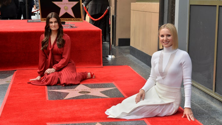 HOLLYWOOD, CALIFORNIA - NOVEMBER 19: Idina Menzel (L) and Kristen Bell (C) are honored with stars on the Hollywood Walk of Fame on November 19, 2019 in Hollywood, California. (Photo by Jerod Harris/Getty Images)