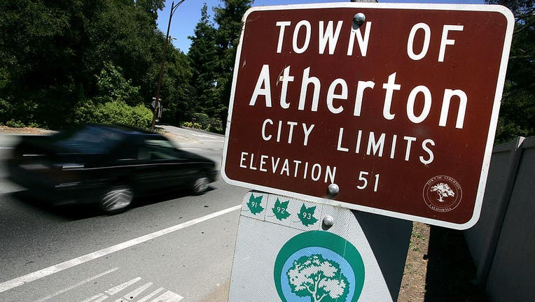 ATHERTON, CA - JULY 12: A car passes by the Town of Atherton city limits sign July 12, 2005 in Atherton, California. According to a recent survey by Forbes.com, Atherton, a small town in the heart of silicon has been called the most expensive ZIP Code, 94027, in the nation, with a median home price of nearly $2.5 million in 2004 and has been attracting several Google employees who are taking advantage of hot company stock options. (Photo by Justin Sullivan/Getty Images)