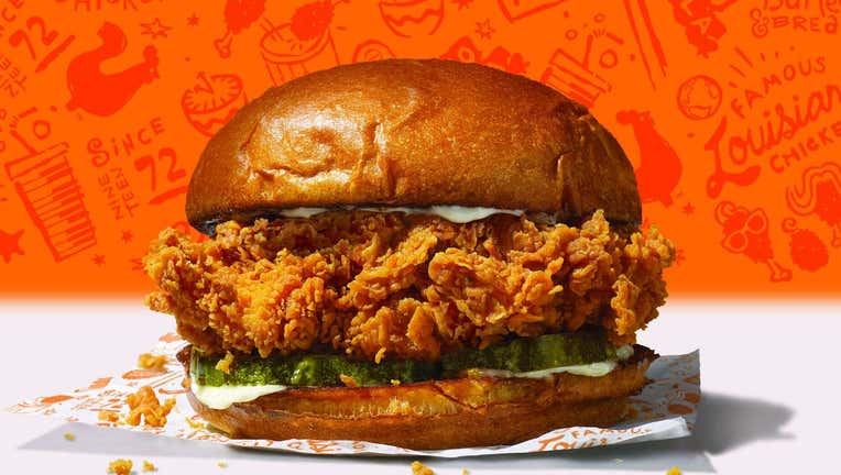 1dbec87e-The sold-out sandwich, which features a buttermilk-battered and hand-breaded chicken filet on a toasted brioche bun, topped with pickles and either mayo or spicy Cajun spread, is making its return. (Photo credit: Popeyes)