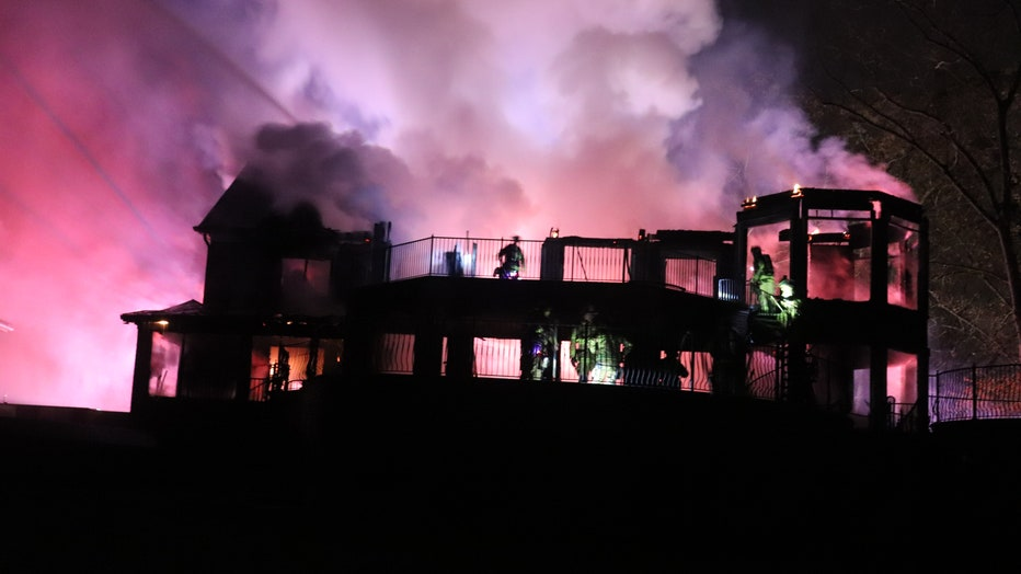 Firefighters battle a two-story house fire in Hall County