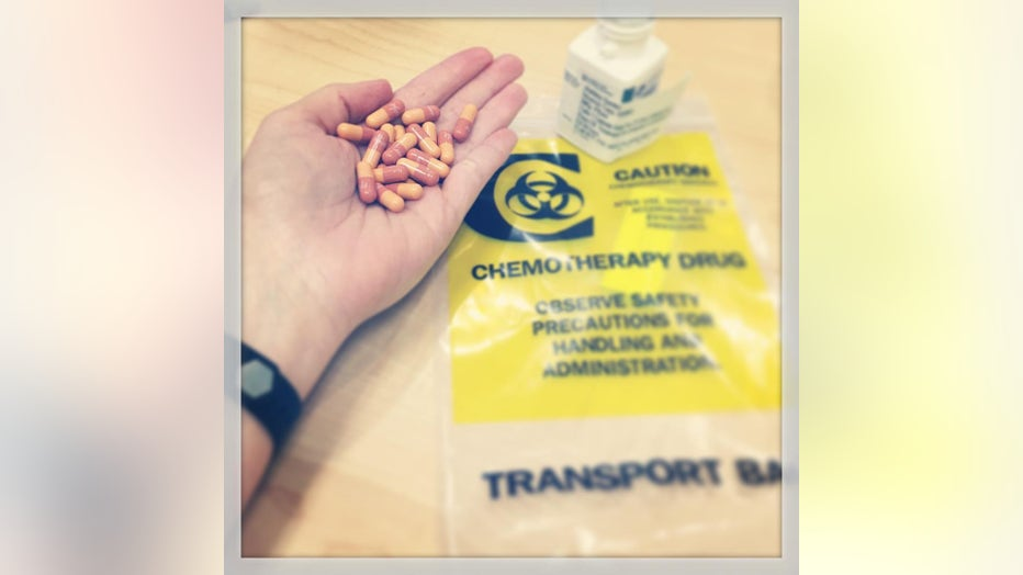 Ashley Gunter holds a handful of chemotherapy pills.