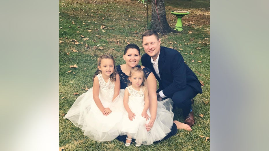 Ashley Gunter poses for a family photo