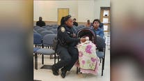 Georgia police officer helps mother with infant in traffic court