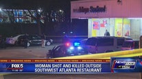 Police searching for gunman who shot mother in parking lot
